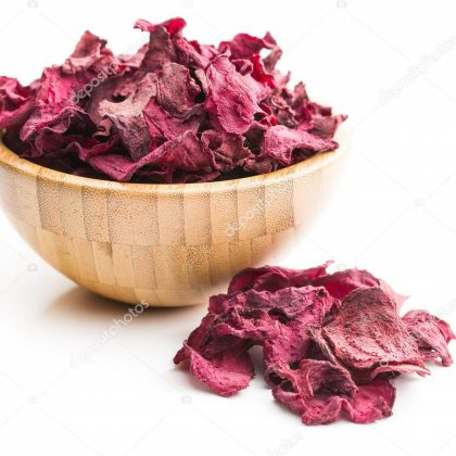 Dried beetroot chips in bowl isolated on white background.